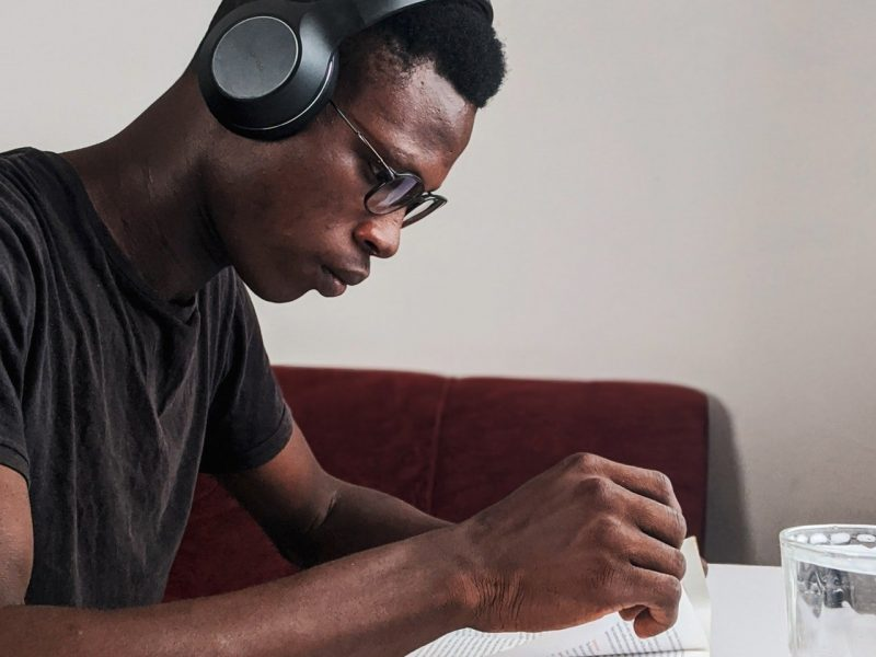 man-wearing-black-crew-neck-t-shirt-using-black-headphones-3466163